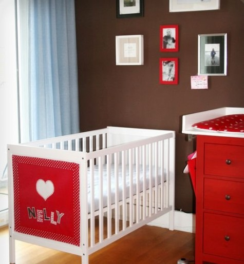 an IKEA Sundvik cot with a colorful fabric accent with the baby's name is a cute way to personalize the space