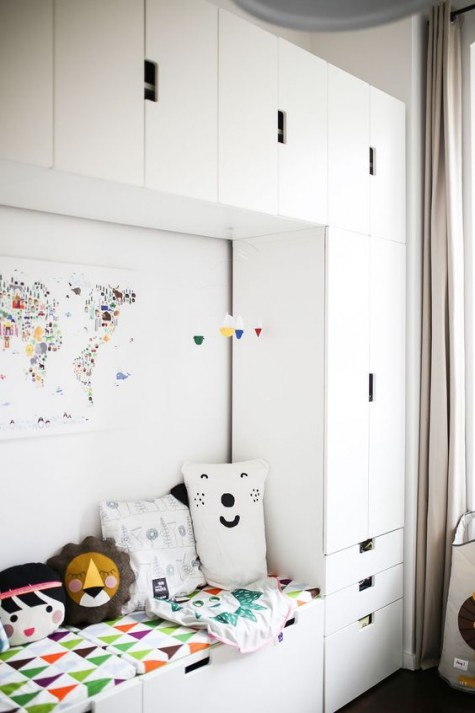 a couch and storage organized in the nursery with IKEA Stuva   smart and functional