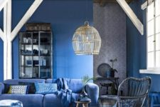 07 classic blue that takes over the space and other shades of blue to support the color making the room monochrome