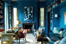 08 classic blue takes over the whole space and looks unusually stylish with a peachy ceiling