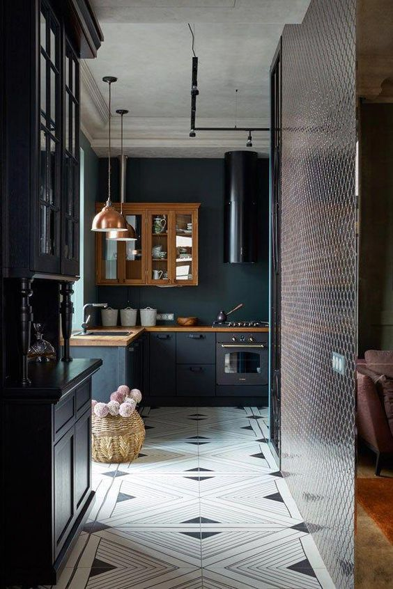 a moody kitchen with graphite grey cabinets, black appliances and touches of vintage style