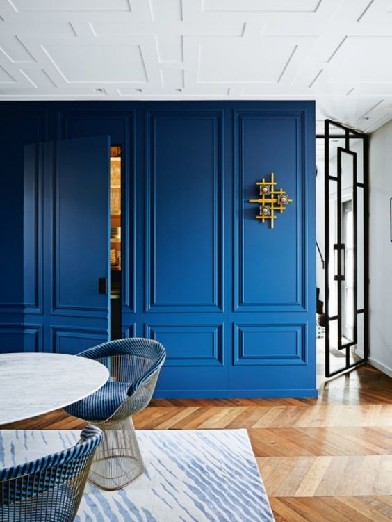a classic blue paneled wall will accent the space and make it trendy and bold