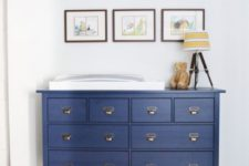 10 a navy IKEA Hemnes dresser with elegant handles is a nice vintage-inspired item for a nursery