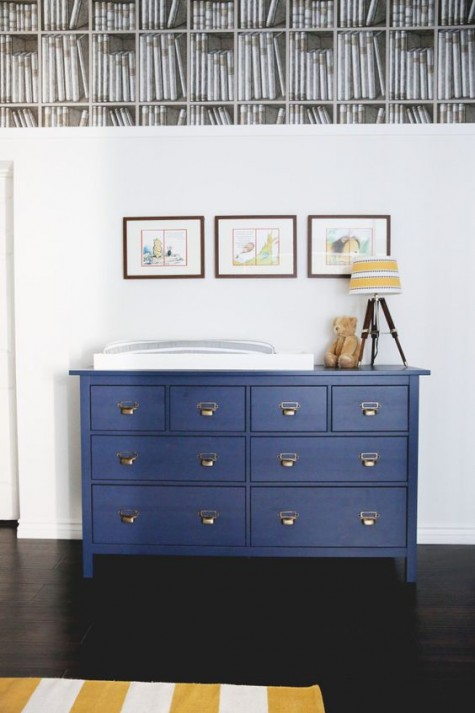 a navy IKEA Hemnes dresser with elegant handles is a nice vintage-inspired item for a nursery