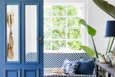 12 a classic blue door and a matching lamp plus a striped bench will make your entryway fresh and bold