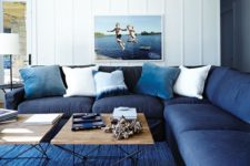 13 a classic blue rug and a navy sofa plus light blue pillows make the space feel beachy