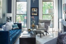 15 a classic blue sofa brings elegance and chic to the space and makes a bold color accent in the space