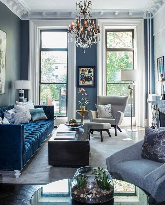 a classic blue sofa brings elegance and chic to the space and makes a bold color accent in the space
