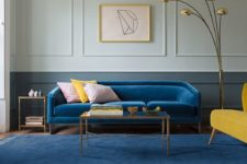 17 a single classic blue sofa and a muted blue rug that echoes make the space colorful and trendy