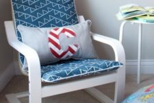 17 an IKEA Poang chair with a new slipcover and a nautical pillow for a coastal or beach nursery