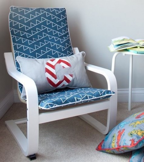 an IKEA Poang chair with a new slipcover and a nautical pillow for a coastal or beach nursery