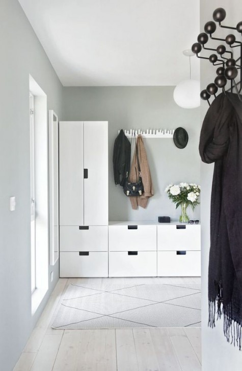 an IKEA Stuva storage unit is ideal for a hallway - it can accommodate a lot of things and will look minimal