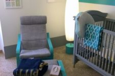 18 a grey Poang chair painted turquoise to match the nursery color scheme perfectly