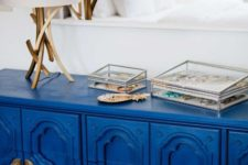18 a super bold classic blue credenza inspired by Asian furniture and spruced up with gold touches