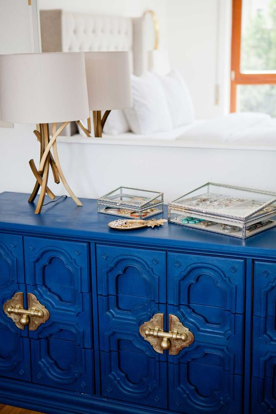 a super bold classic blue credenza inspired by Asian furniture and spruced up with gold touches