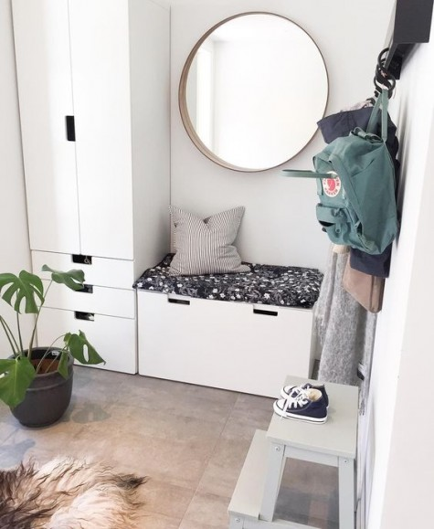 an IKEA Stuva system in the entryway is a great and compact idea, add a mattress as a seat for your bench