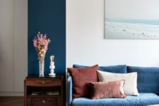 19 a touch of classic blue brought with a sofa and highlighted with a teal stripe on the wall