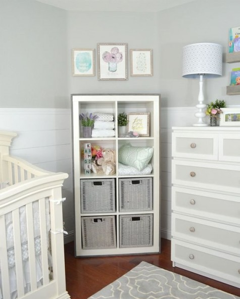 a Kallax shelving unit with basket drawers is a stylish idea for a rustic nursery