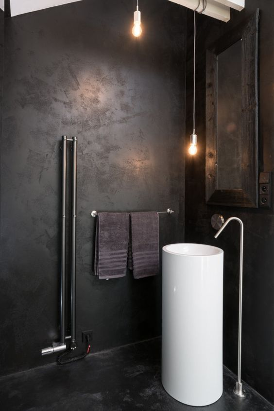 a minimalist meets industrial bathroom with a free-standing white round sink