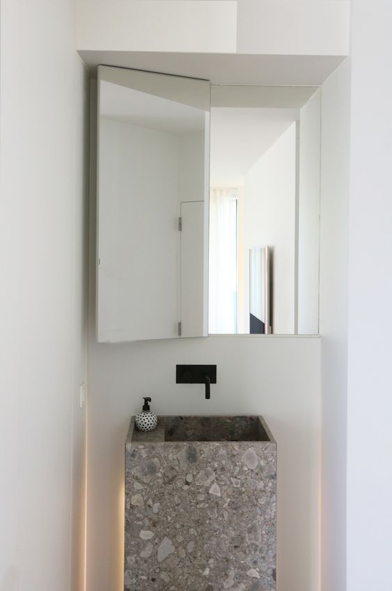 make a modern statement with a grey stone minimal sink that can be squeezed anywhere