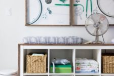 23 an IKEA Expedit storage unit covered with stained wood is a cool changing table, too