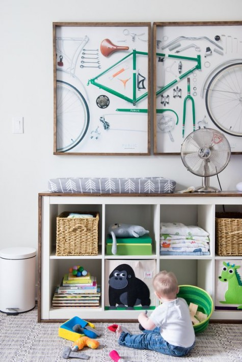 an IKEA Expedit storage unit covered with stained wood is a cool changing table, too