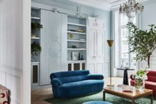 23 bright classic blue sofas and an ottoman for a trendy colorful touch in the space