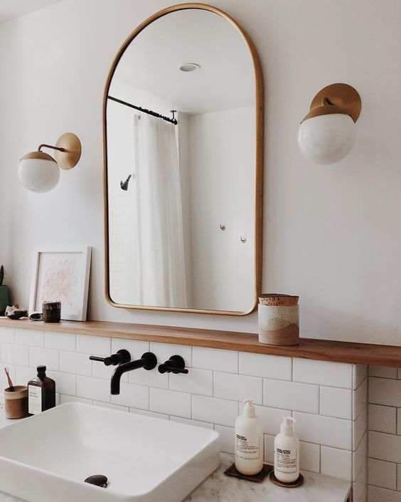 matte brass fixtures like these ones will give a slight vintage and refined feel to the bathroom