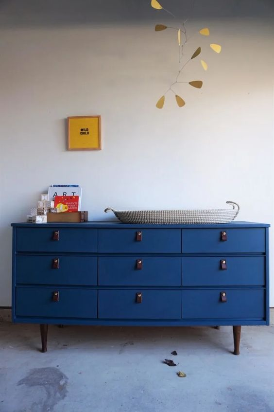 paint the changing table with classic blue paint to add a trendy accent to the space
