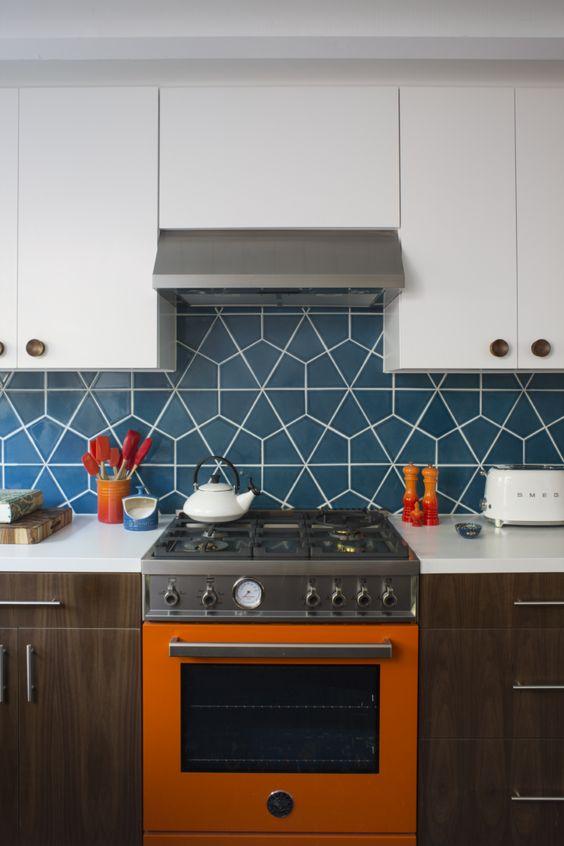 a trendy two tone kitchen with a deep blue geometric tile backsplash that makes it wow