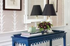25 paint the console table in bold classic blue for a simple and easy colorful touch to the space