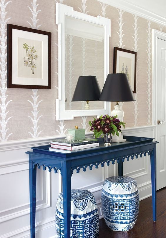 paint the console table in bold classic blue for a simple and easy colorful touch to the space