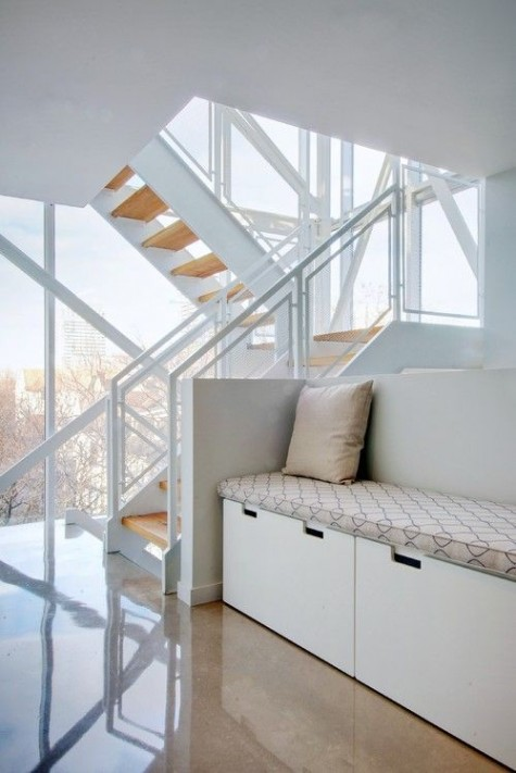 you can use IKEA Stuva in an awkward corner of the stairs   turn it into a daybed adding a mattress and some pillows