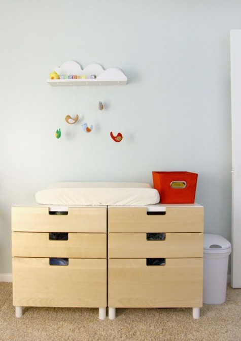 an IKEA Stuva storage system doubles as a changing table and looks minimal