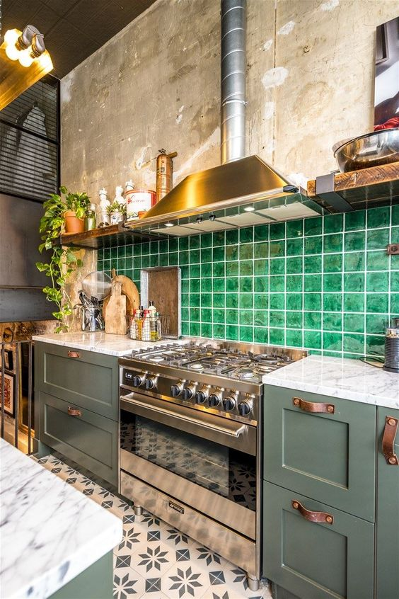 an olive green kitchen with brass touches and a super bright green tile backsplash accented with white grout