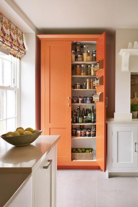 a bright kitchen larder cupboard used for food storage is a cool colorful accent