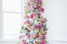 a beautiful and romantic Valentine tree decorated wuth fresh flowers in pink, blush and yellow plus foliage