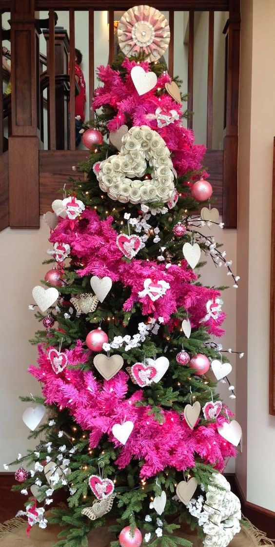 a bright Valentine tree with pink stripes, lights, cherry blossom, usual and heart ornaments and paper decor