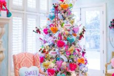 a bright and fun Valentine's Day tree decorated with hearts, donuts, lights and colorful ornaments of all kinds