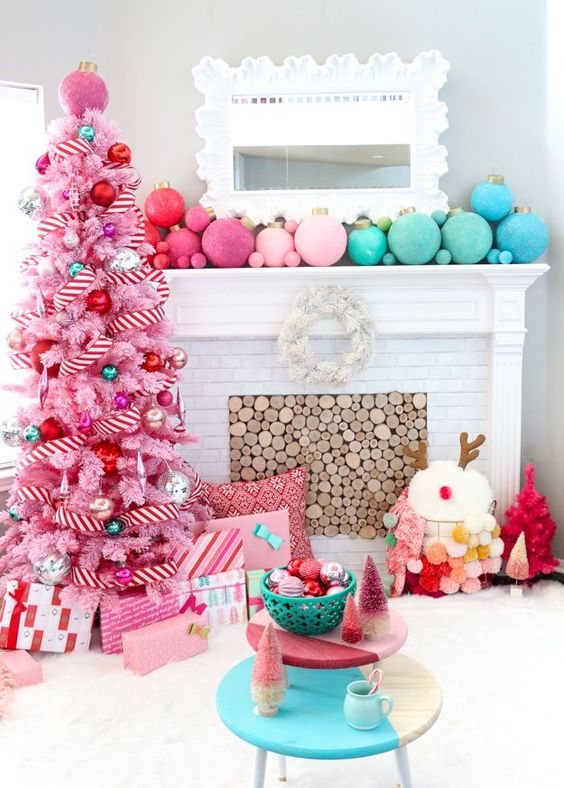a bright pink tree decorated with shiny and glitter ornaments of various candy colors