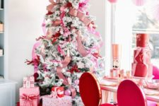 a chic Valentine tree with striped ribbons, pink ornaments and red twigs is a very romantic idea