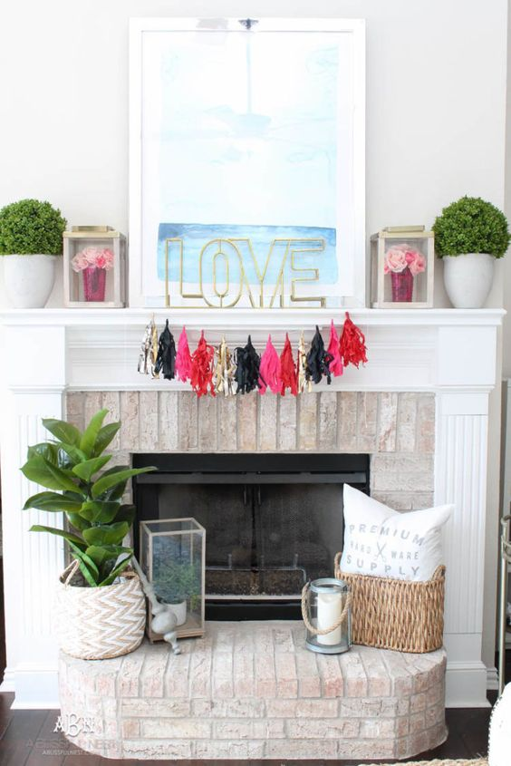 a colorful tassel garland, bright blooms in lanterns and LOVE letter plus a dreamy artwork