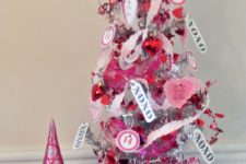a cute tabletop Valentine tree in silver, with tags, pink ribbons, mini paper hearts and toppers