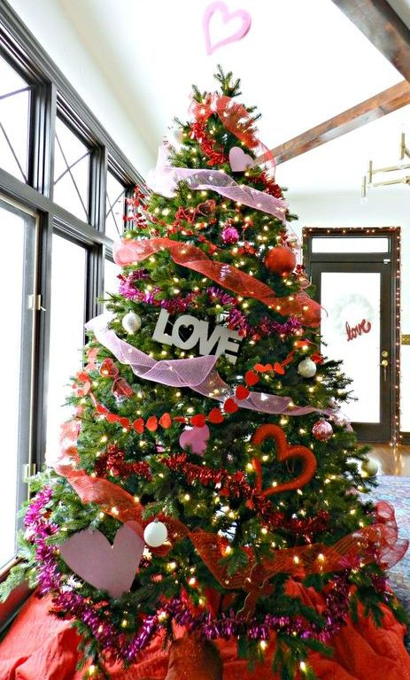 a gorgeous Valentine tree with pink and red ribbons, lights, LOVE letters and heart decor looks wow