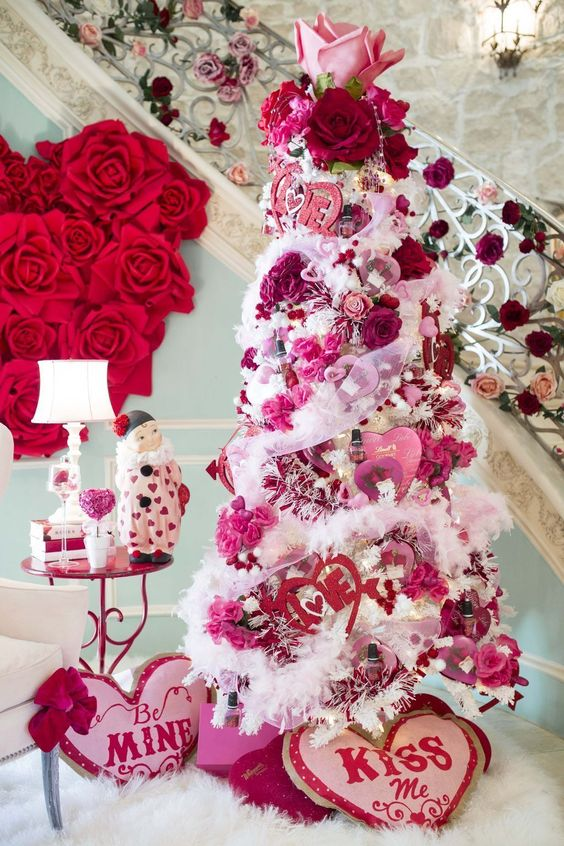 a luxurious Valentine tree with pink and deep red blooms, hearts and garlands plus gorgeous flower toppers