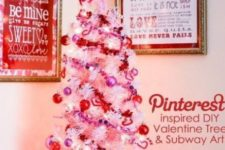 a mini white tree with lights and glitter pink and red ornaments plus a pink bow on top is a cute idea