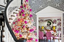 a snowy tree decorated with gold and pink ornaments will do not only for Christmas but also for Valentine's Day