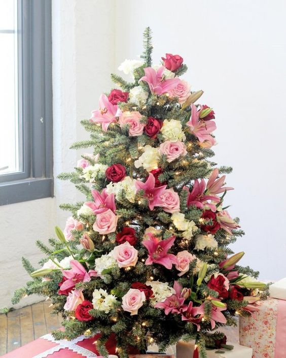 a super romantic Valentine tree with hot pink, blush and neutral fresh flowers looks really beautiful and amazing