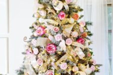 an exquisite Valentine tree decorated with gold ribbons, pink and blush fabric blooms and blush ornaments
