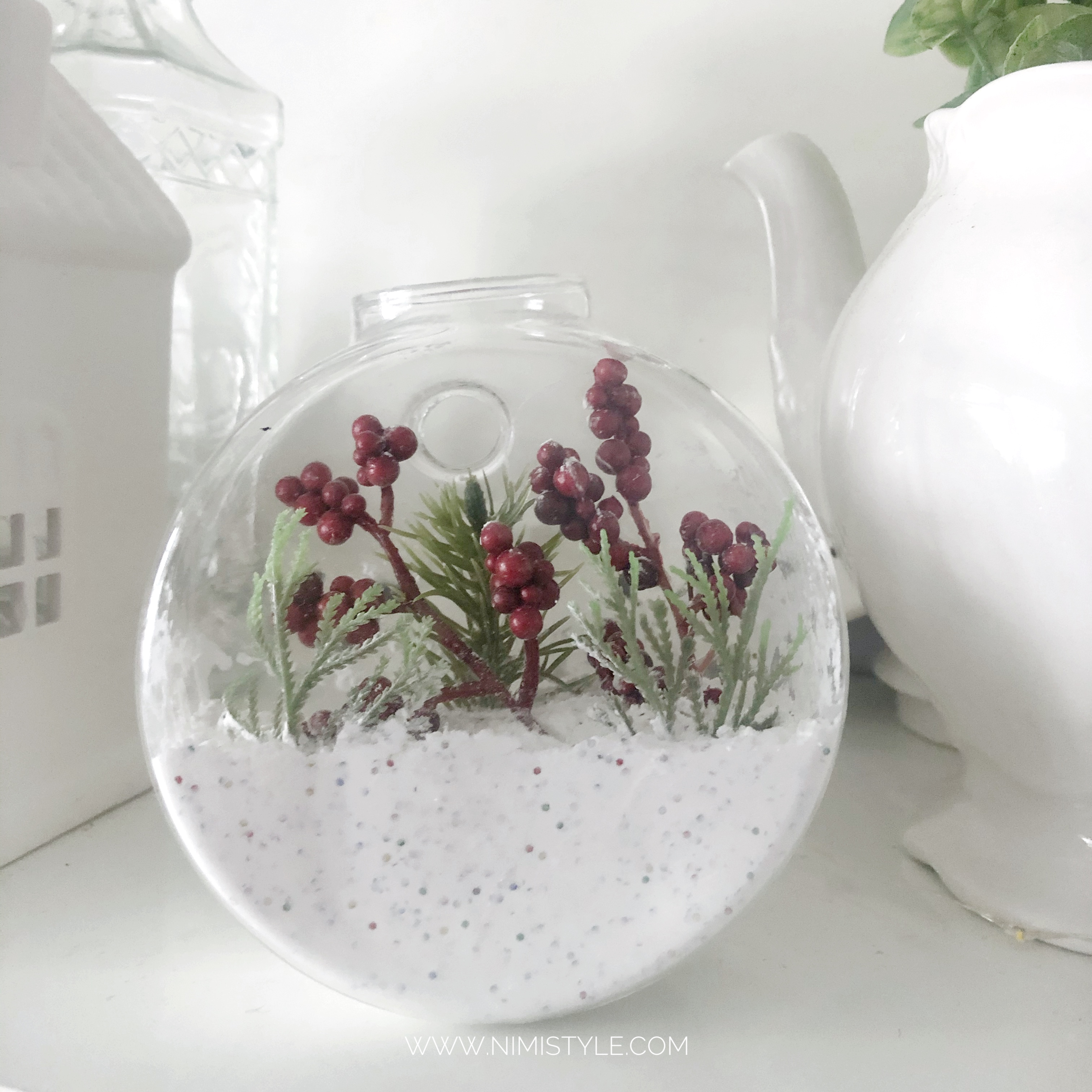 DIY winter terrarium with faux snow and faux plants
